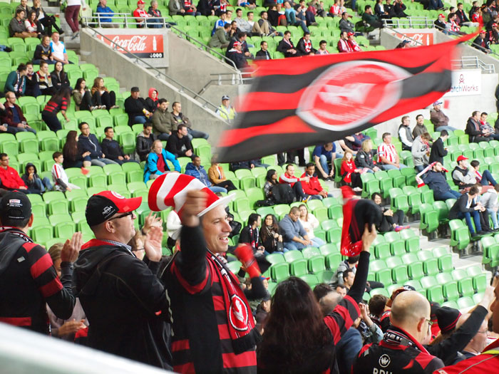 A Wanderers fan with a daft hat waves a flag, while in the background Heart supporters exhibit the kind of cool indifference that makes Dimitar Berbatov look needy.