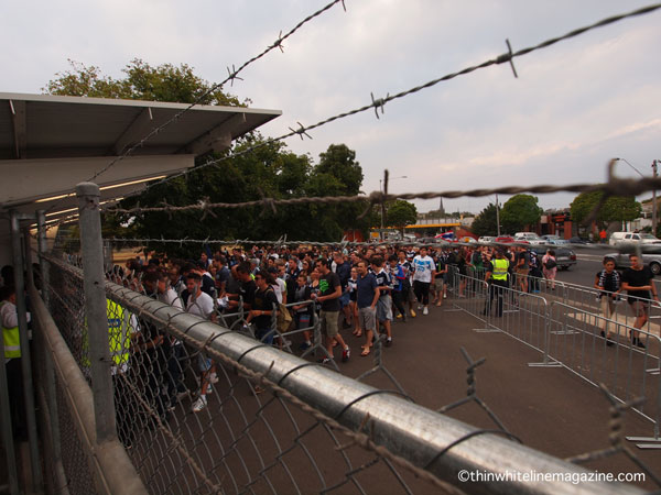 Home and away supporters arriving at the stadium in an orderly fashion.