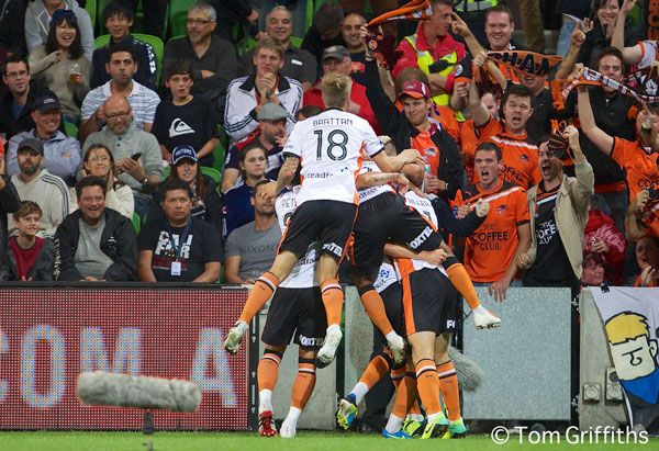 Luke Brattan and his Brisbane Roar teammates celebrate scoring a goal against Melbourne Victory.