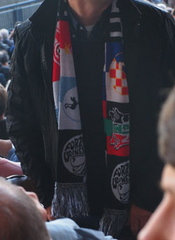 What is this? A half-and-half-and-half-and-half scarf? Festooned with the logos of some of Udinese's recent European opponents. This bloke wasn't the only person wearing a scarf like this at the stadium. Think about that.
